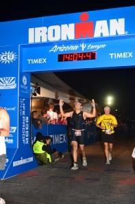 Me crossing the Ironman Arizona Finish Line, just a couple years after believing that I'd never be a runner again.